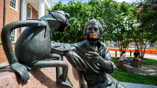Kermit and Jim Henson statue wearing Maryland face masks in front of the STAMP Student Union