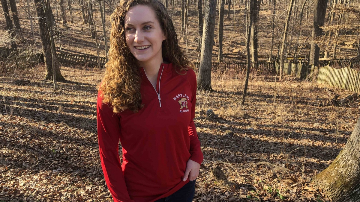 Carly Jimeson '15 wearing the new Alumni Association red quarter-zip sweatshirt