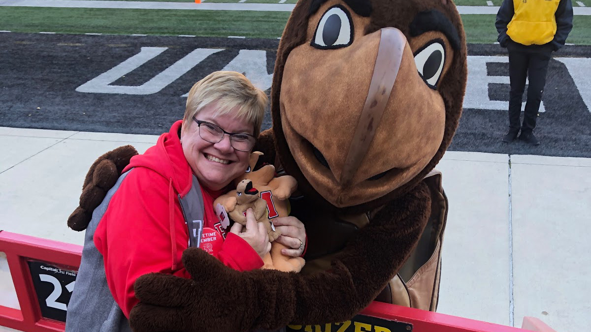 Noreen Welch '90 with Testudo at a Maryland game