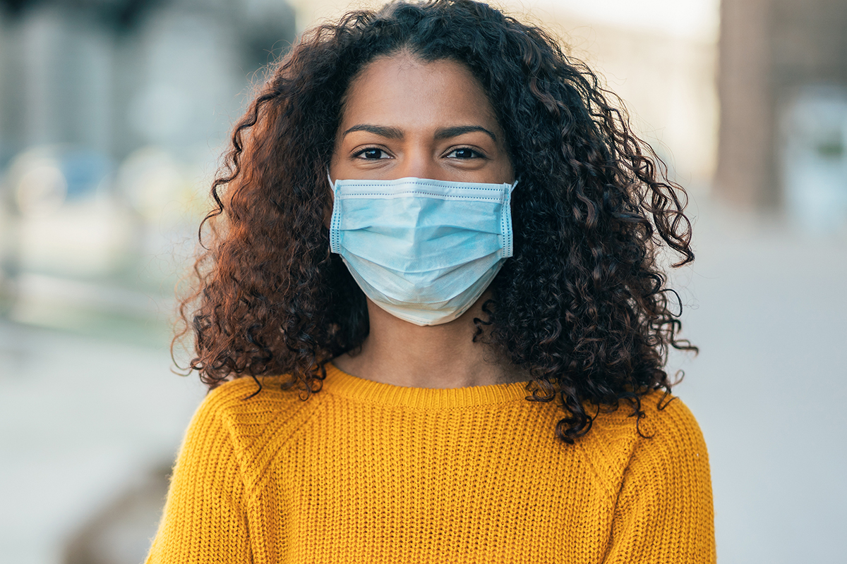 woman looking at camera with face mask on