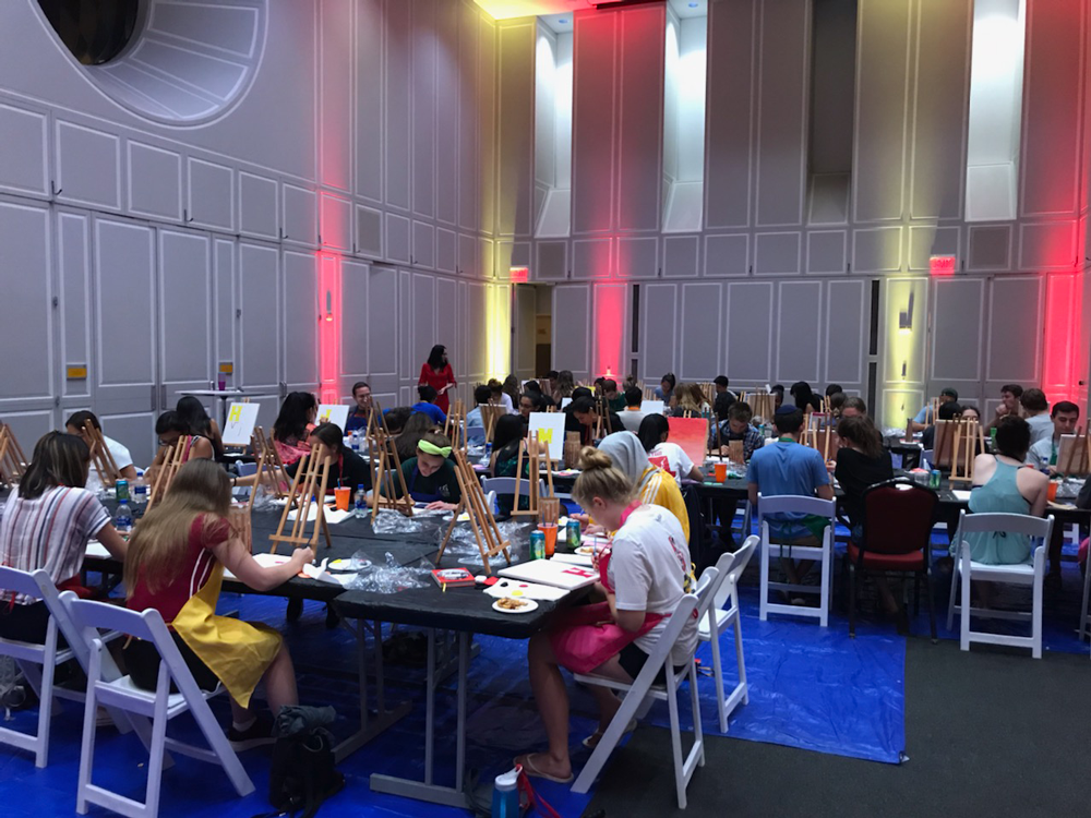 Students painting at a Terps After Dark event