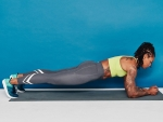 Woman performing the plank exercise.